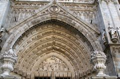 Detail of the arch of the Catholic Cathedral in Toledo, Spain. Medieval Christian Catholic Cathedral in Toledo, Spain. Arch, sculpture and decoration of the Stock Photography