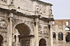 Detail of the Arch of Constantine. The arch is located near the Colosseum and is designed to commemorate the victory of stock photography