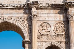 Detail of the Arch of Constantine near the Roman Colosseum, land. Mark and symbol of Rome, Italy Royalty Free Stock Photo