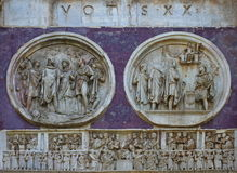 Detail of the Arch of Constantine - landmark attraction in Rome, Italy. Relief panels, round reliefs and frieze on the Arch of Constantine, detail - landmark Royalty Free Stock Photography