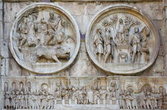 Detail of the Arch of Constantine - landmark attraction in Rome, Italy. Relief panels, round reliefs and frieze on the Arch of Constantine, detail - landmark stock image