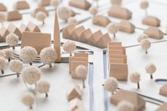 Detail of an Architectural Model of a Village with Church. Detail of an architectural model of a village with small traditional homes, toned white and blue and a royalty free stock image