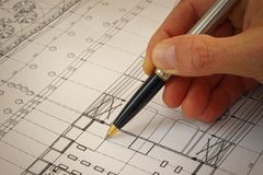 Detail of architectural project plans. Architect showing details with pen Royalty Free Stock Images
