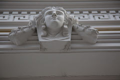 Detail architecture bas relief head woman white stone Royalty Free Stock Images