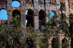 Detail of architecture of Colosseum Rome. Travel to Italy, Europe. Colosseum Rome. Ruins of the  ancient Roman amphitheatre. Travel to Italy, Europe. Crowd and Stock Photo