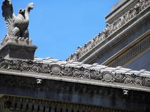Detail of architecture: National Archives, Washington DC. Federal eagle and stone scrollwork on the National Archives Research Center on Constitution Avenue in royalty free stock photo