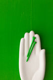 Detail of artifical hand with golf equipments Royalty Free Stock Images