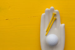 Detail of artifical hand with golf equipments Royalty Free Stock Image