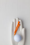 Detail of artifical hand with golf equipments Stock Photo