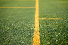 Detail of an artificial turf with yellow lines Stock Images