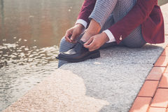 Detail of an Asian model posing by an artificial basin Stock Photo