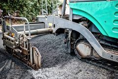 Detail of asphalt paver machine during road construction Royalty Free Stock Photography