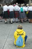 Detail of the assistants to the holy mass. LOURDES, FRANCE - JULY 6, 2016: Detail of the assistants to the holy mass Some with a Scottish skirt, near the stock photography