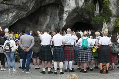 Detail of the assistants to the holy mass in Lourdes France. LOURDES, FRANCE - JULY 6, 2016: Detail of the assistants to the holy mass Some with a Scottish skirt stock photography