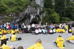 Detail of the assistants to the holy mass in Lourdes France. LOURDES, FRANCE - JULY 6, 2016: Detail of the assistants to the holy mass Some with a Scottish skirt royalty free stock photos