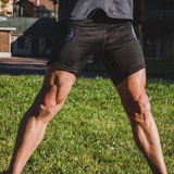 Detail of an athlete stretching in a city park Royalty Free Stock Photo