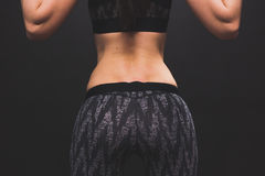 Detail of an athletic girl doing workout in the gym Royalty Free Stock Photo