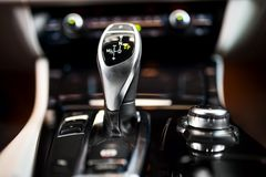 Detail of an automatic gear stick in a new, modern car Stock Image