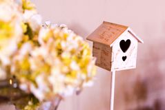Detail of baby shower for girl, bird cage and bouquet of flowers. royalty free stock image