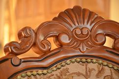 Detail of back an decorative wooden chair. With padding Stock Photo