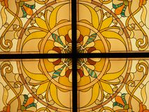 Detail of a back lit stained glass window with vibrant colors royalty free stock photography