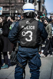 Detail of the Back of a Police Facing protesters. Stock Photo