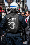 Detail of the Back of a Police Facing protesters. Royalty Free Stock Photography