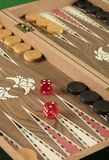 Backgammon game with two dice. Detail of a backgammon game with two dice close up royalty free stock image