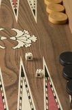 Backgammon game with two dice. Detail of a backgammon game with two dice close up royalty free stock photography
