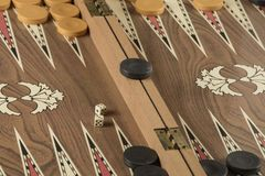 Backgammon game with two dice. Detail of a backgammon game with two dice close up stock images