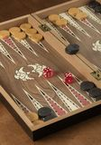 Backgammon game with two dice. Detail of a backgammon game with two dice close up royalty free stock images