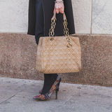 Detail of bag and shoes outside Cristiano Burani fashion show bu Stock Images