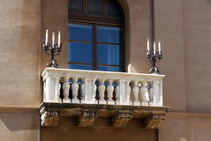 Detail of balcony with candle holders. A particular balcony with balaustrade and two candle holders in Palermo, Sicilia, landscape cut Stock Photos