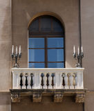 Detail of balcony. A particular balcony with balaustrade and two candle holders in Palermo, Sicilia Stock Images