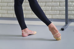 Detail of ballet dancers feet, close up of pointe shoes royalty free stock images