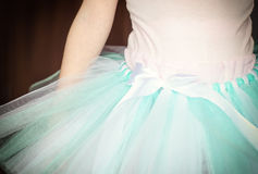 Detail of ballet tutu. Little girl dressed in ballet tutu, closeup, detail on ribbon Royalty Free Stock Images