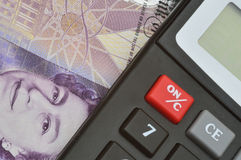 Detail of banknote and calculator Stock Photos