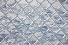 Detail of barbwire covered by snow. Close-up of barbwire covered by snow stock photography