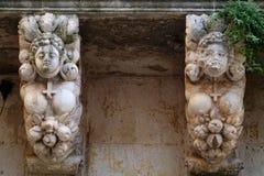 Detail of a baroque balcony in Lecce, Salento - Italy. Detail of a baroque balcony with women and inverted cross in Lecce, Salento - Italy Stock Photography