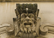 Detail of a baroque decoration with a demon face, Royalty Free Stock Photo