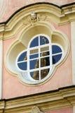 Detail of Baroque elliptic framed window reflecting Fieschi chur. Detail of Baroque elliptic framed window reflecting historical Romanesque Fieschi church near Stock Photo