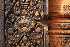 Detail of bas-relief carving at temple column, Ang Royalty Free Stock Images