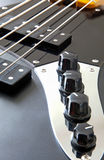 Detail of bass guitar. Detail of a black bass guitar royalty free stock image