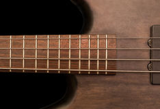 Detail of a bass guitar Royalty Free Stock Image