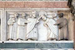 Bass-relief representing the Stories of St. Martin, Cathedral of St. Martin in Lucca, Italy royalty free stock photos
