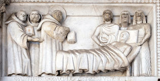 Bass-relief representing the Stories of St. Martin, Cathedral of St. Martin in Lucca, Italy stock images