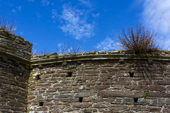 Detail of Battlements, Construction at Historic Bayards Cove Fort with Blue Sky; River Dart, Dartmouth, Devon, England. Detailed view looking up at the Stock Photography