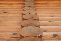 Detail of beams in cabin wall. Painted wood with fungicide paint. Closeup of many elements another view stock images