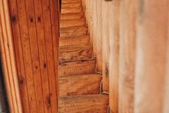Detail of beams in cabin wall. Painted wood with fungicide paint. Closeup of many elements Bottom view royalty free stock images