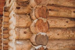 Detail of beams in cabin wall. Painted wood with fungicide paint. Corner of a wooden house from logs another view stock images